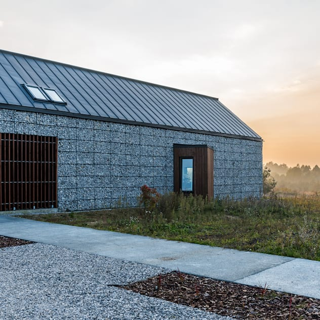 Casas de estilo moderno por Kropka Studio
