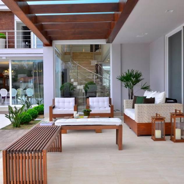 Residencial Unifamiliar: Terraços  por Marcelo John Arquitetura e Interiores