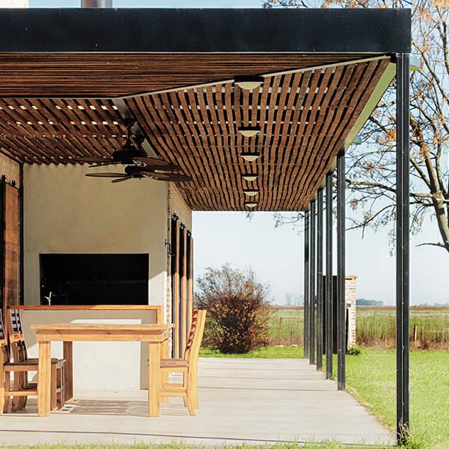 Nhà phong cách đồng quê bởi BAM! arquitectura Đồng quê