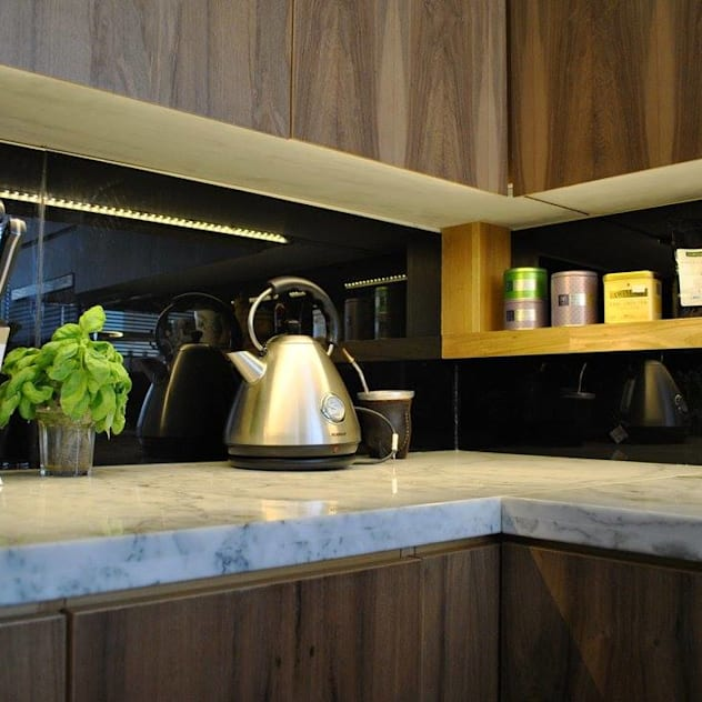 Depto DLH: Cocinas de estilo moderno por T + T Arquitectos