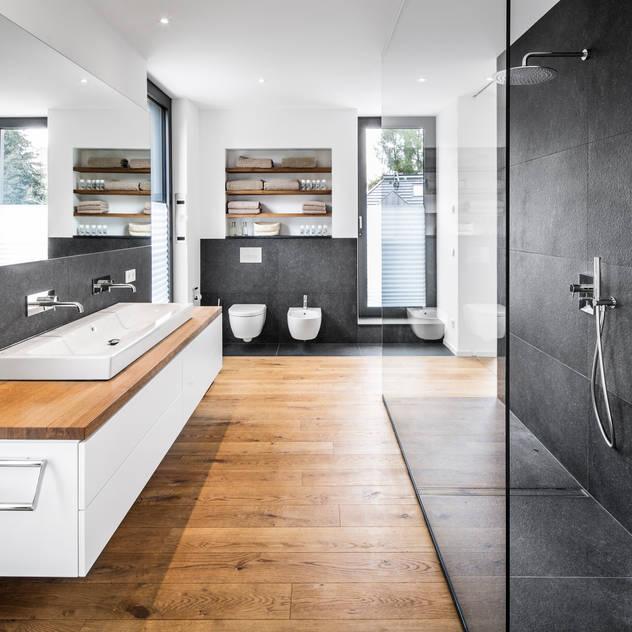 Phòng tắm phong cách hiện đại bởi Corneille Uedingslohmann Architekten Hiện đại
