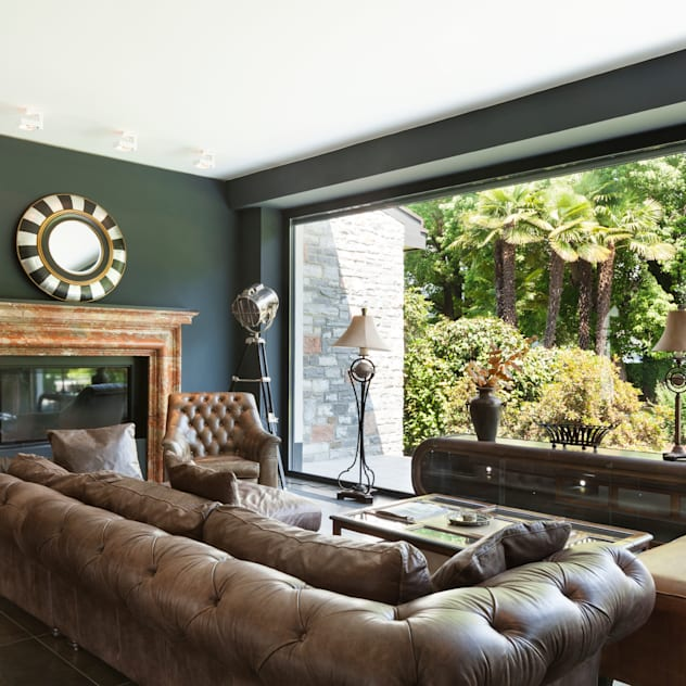 Dark Moody Living Space Rustic style living room by Gracious Luxury Interiors Rustic