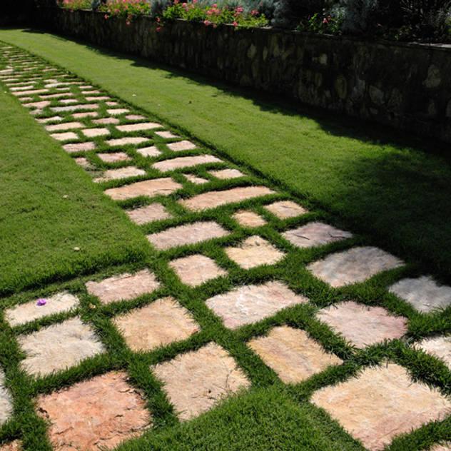 Jardines de estilo rústico por Arte Pietra