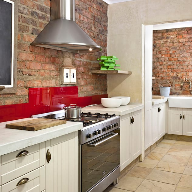 Renovated cooking area by Deborah Garth Interior Design International (Pty)Ltd Rustic