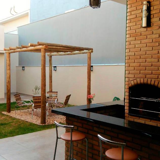 Vườn phong cách hiện đại bởi Fávero Arquitetura + Interiores Hiện đại