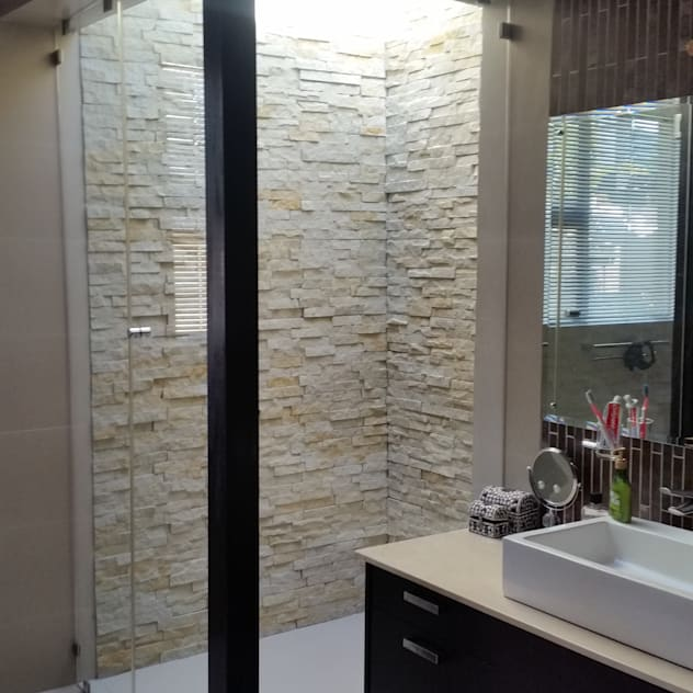 Walk in rain shower: Bathroom shower tile design by Stacy Steel Works and Renovations