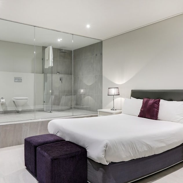 The modern Camps Bay home with a 12 Apostles view FRANCOIS MARAIS ARCHITECTS Modern style bedroom White