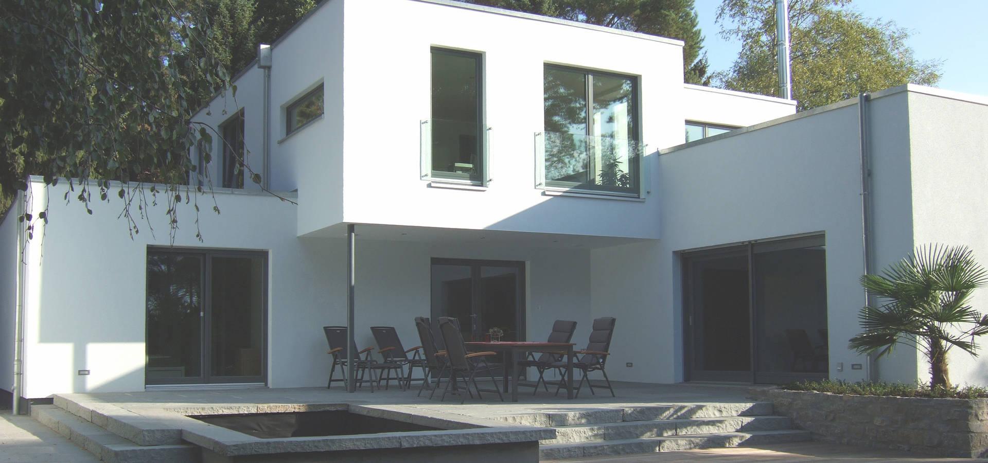 siedlungshaus mit holzscheibe von zymara und loitzenbauer architekten bda homify. Black Bedroom Furniture Sets. Home Design Ideas