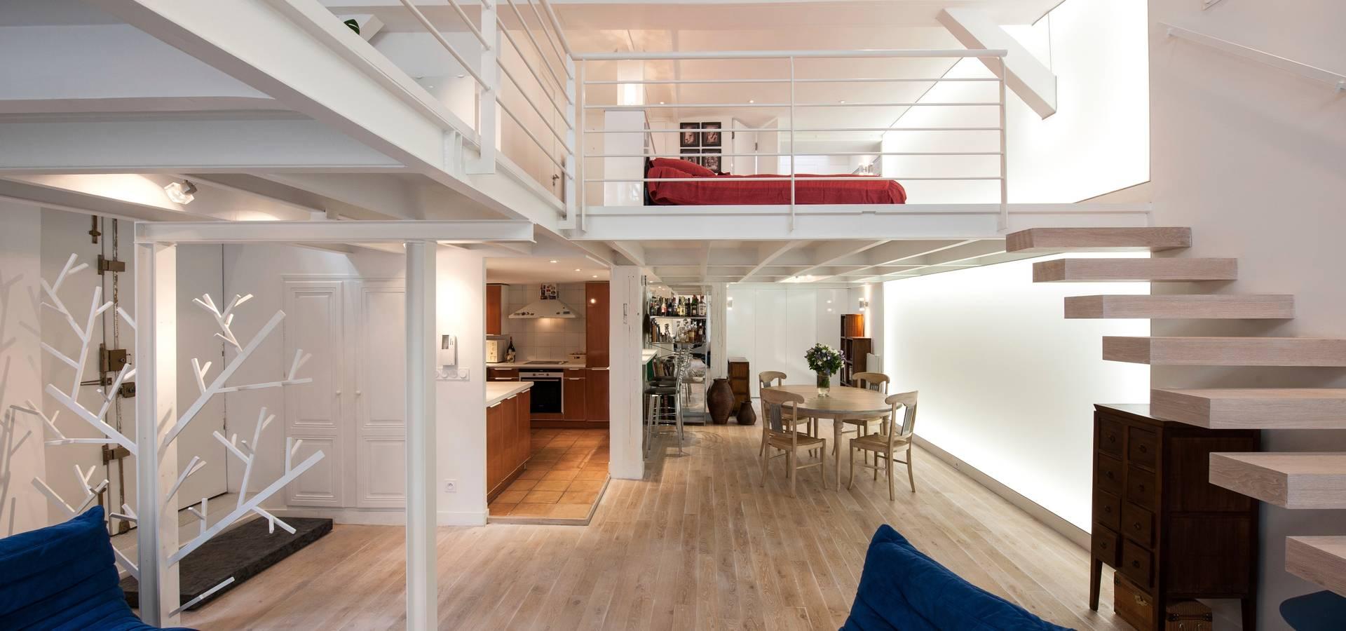Salon ouvert sur la salle à manger von Fables de murs   homify