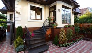 Projekty, klasyczne Domy zaprojektowane przez AGRAFFE design
