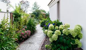 Jardines de estilo clásico por Gzowska&Ossowska Pracownie Architektury Wnętrz