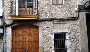 TAQ: Casas de estilo rústico de Espais Duals