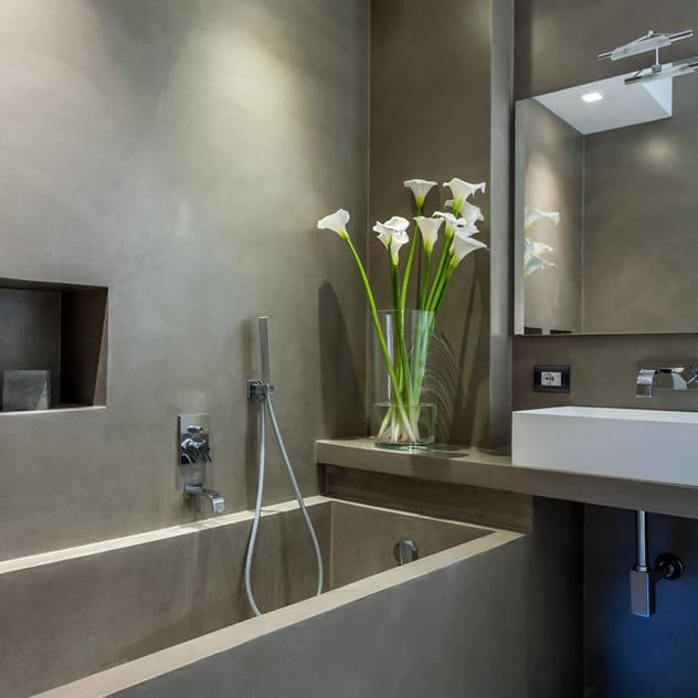 Banheiros modernos por zero6studio - Studio Associato di Architettura