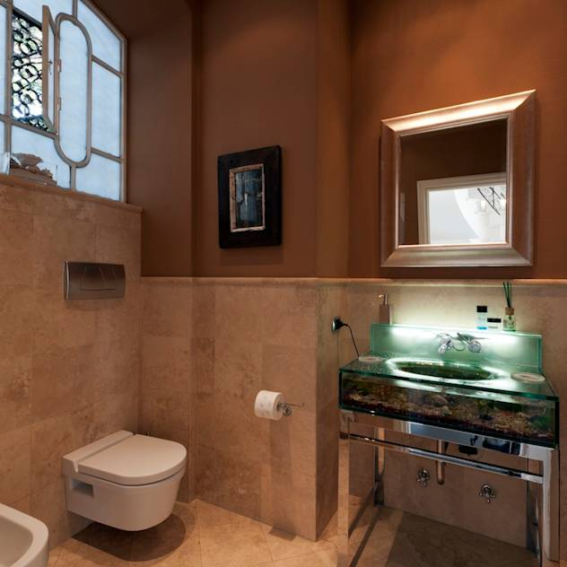 Banheiros modernos por studiodonizelli