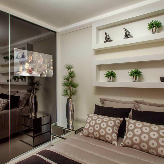 Apartamento Ribeirão Preto: Quartos translation missing: br.style.quartos.moderno por Designer de Interiores e Paisagista Iara Kílaris
