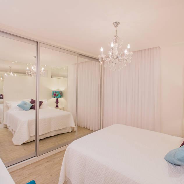 Apartamento em Cascavel: Quartos translation missing: br.style.quartos.classico por Evviva Bertolini