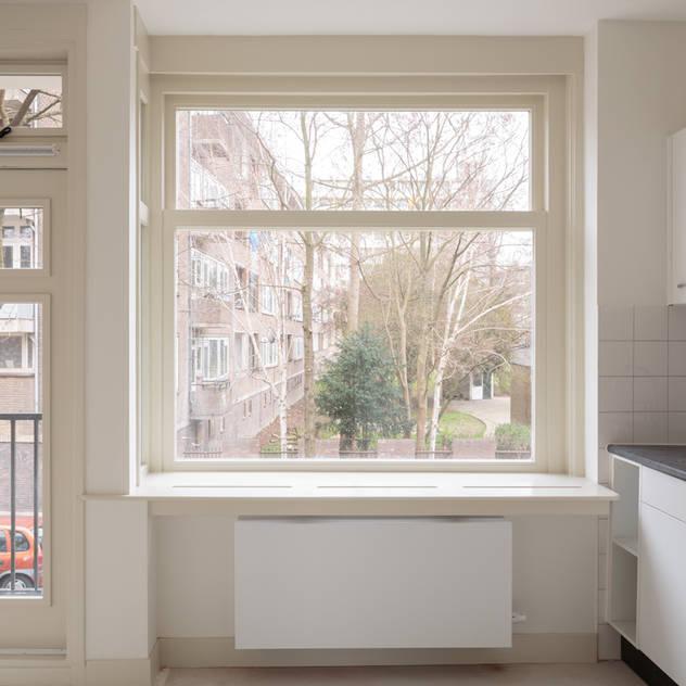 Cozinhas minimalistas por Studio LS