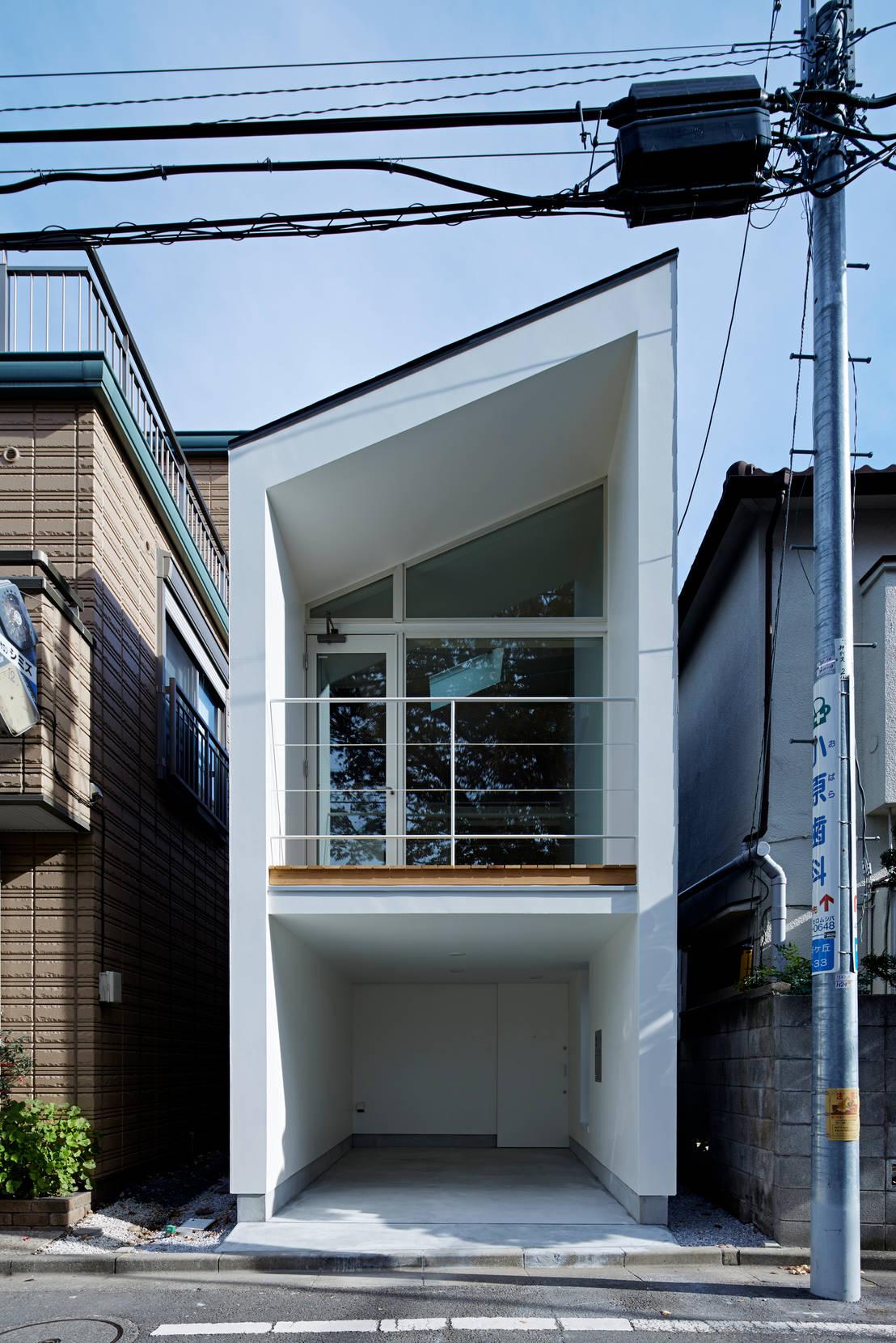 Von another apartment ltd homify for Fachadas de casas modernas entre medianeras