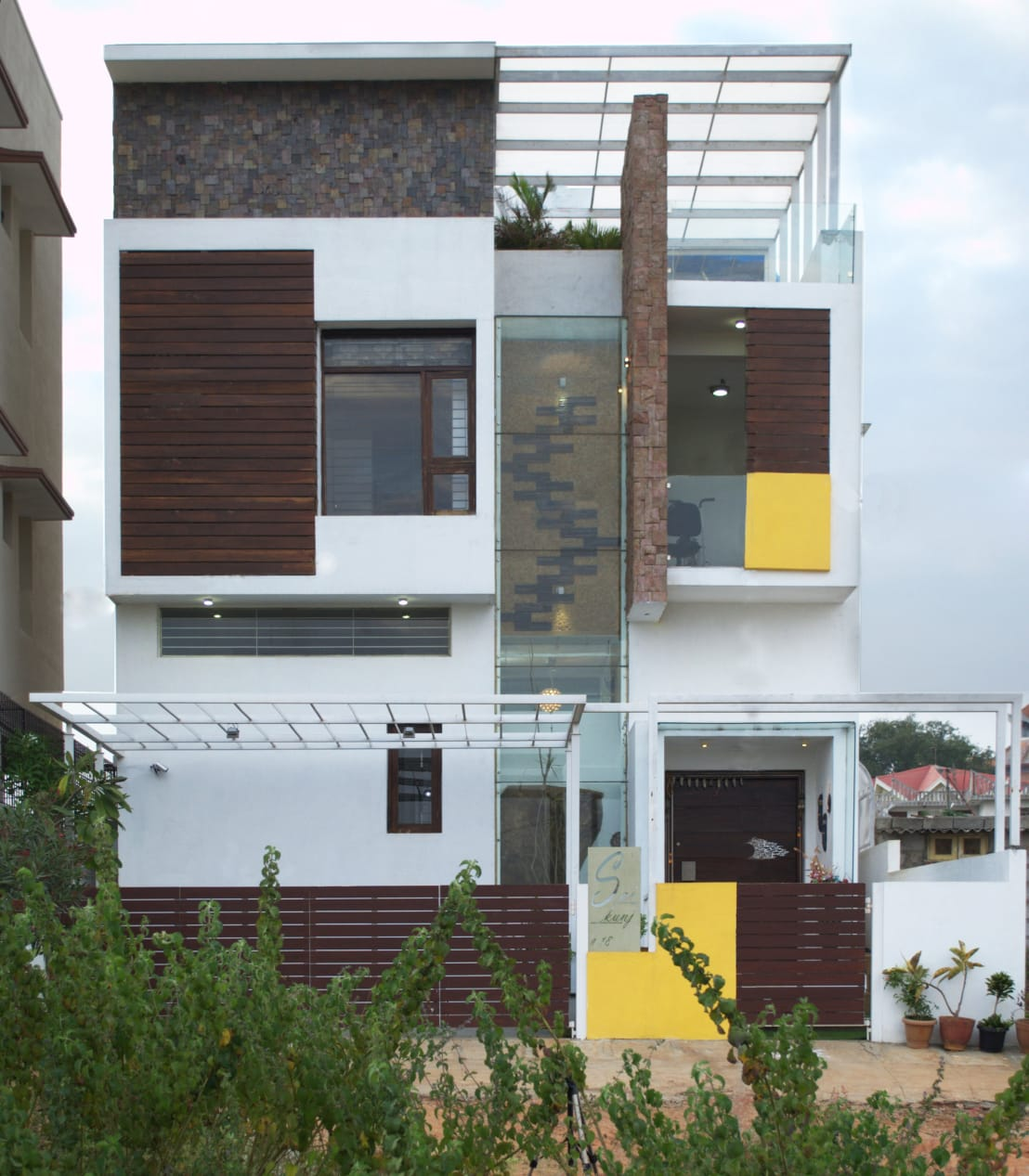 A contemporary and creative 3 storied house in bangalore for Contemporary house names
