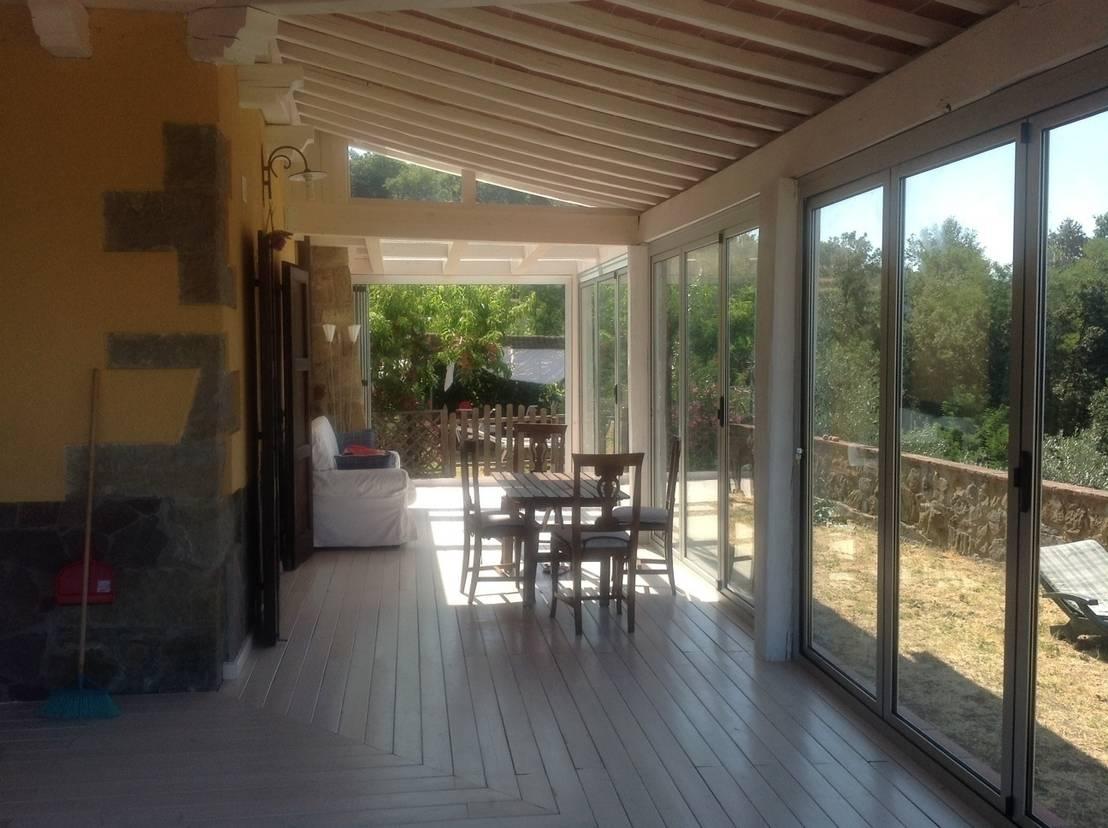 Veranda in legno toscana de le verande srls homify - Ampliamento casa con veranda ...