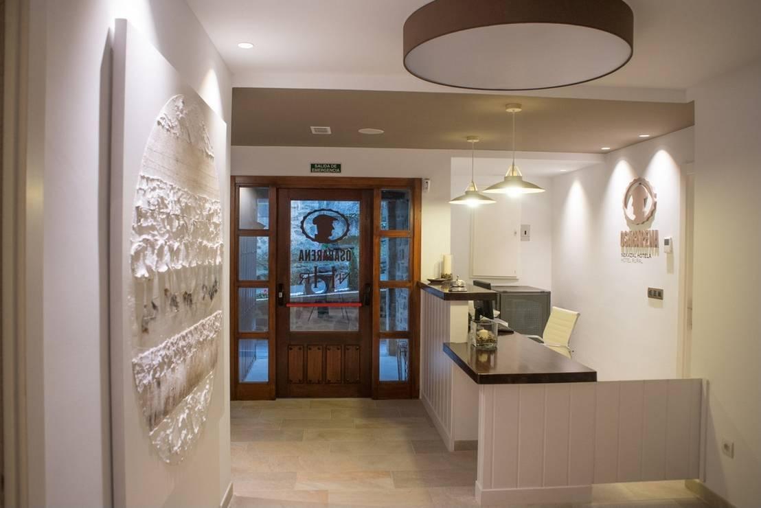 Hotel rural osabarena de temas rojo homify for Decoradores de interiores en bilbao