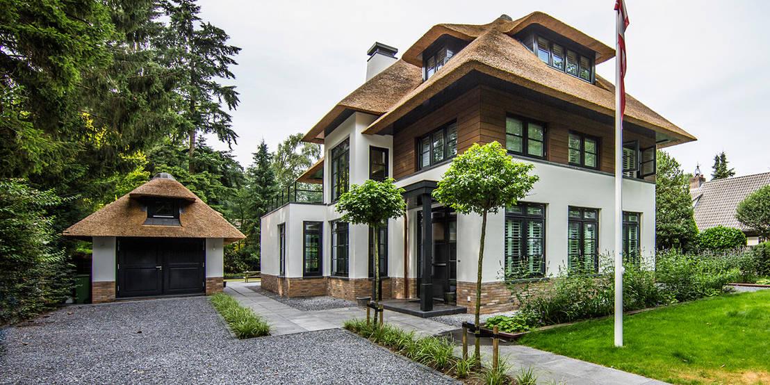 7 idee n om van je gewone oprit een spectaculaire entrance for Moderne aanbouw aan klassiek huis