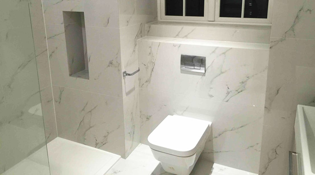 En Suite Bathroom With Carrara Marble Effect Porcelain
