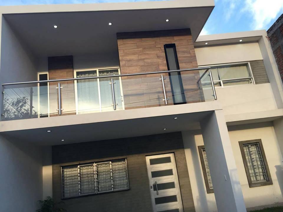 Barandales extraordinarios que adornar n tu fachada for Fachada de casas modernas con vidrio