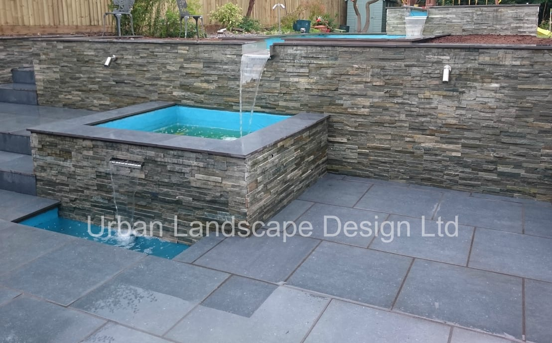 Split level garden with water feature by urban landscape for Suzhou architecture gardens landscape planning design company limited