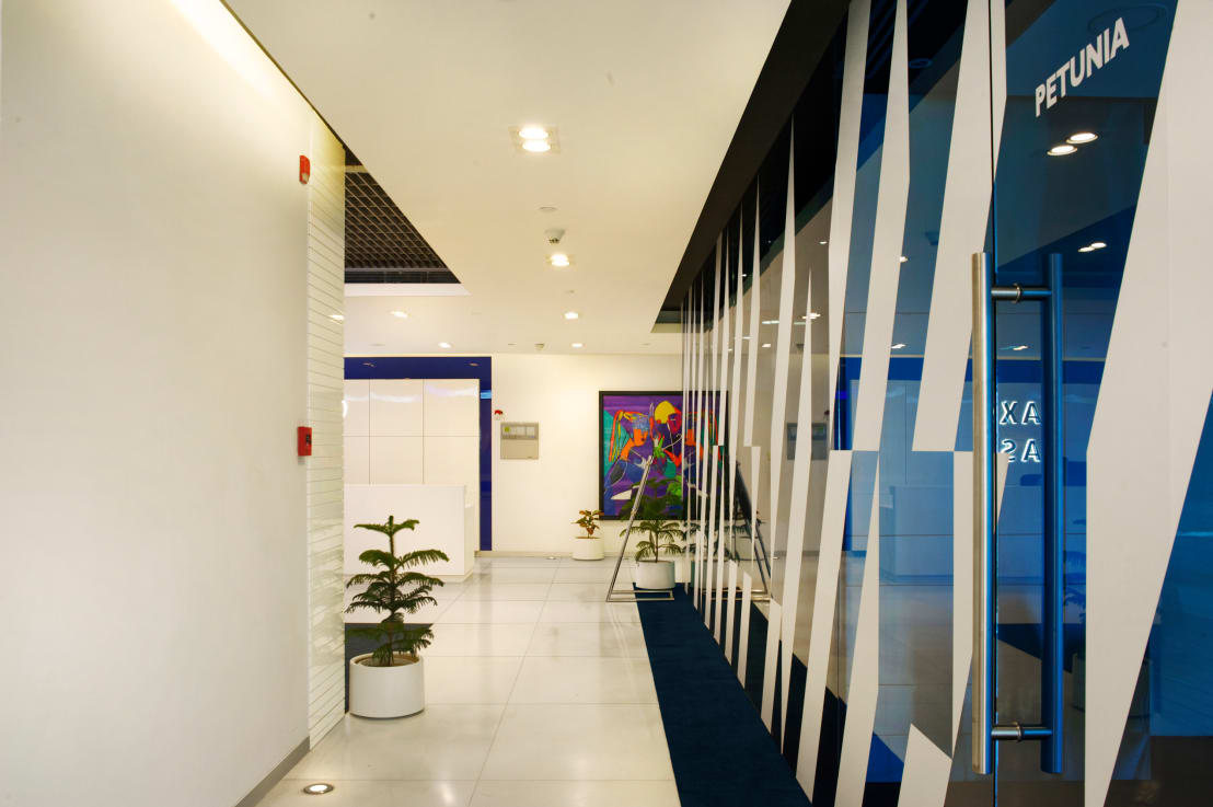 Saxo bank commercial space project by praxis design for Modern design building services ltd