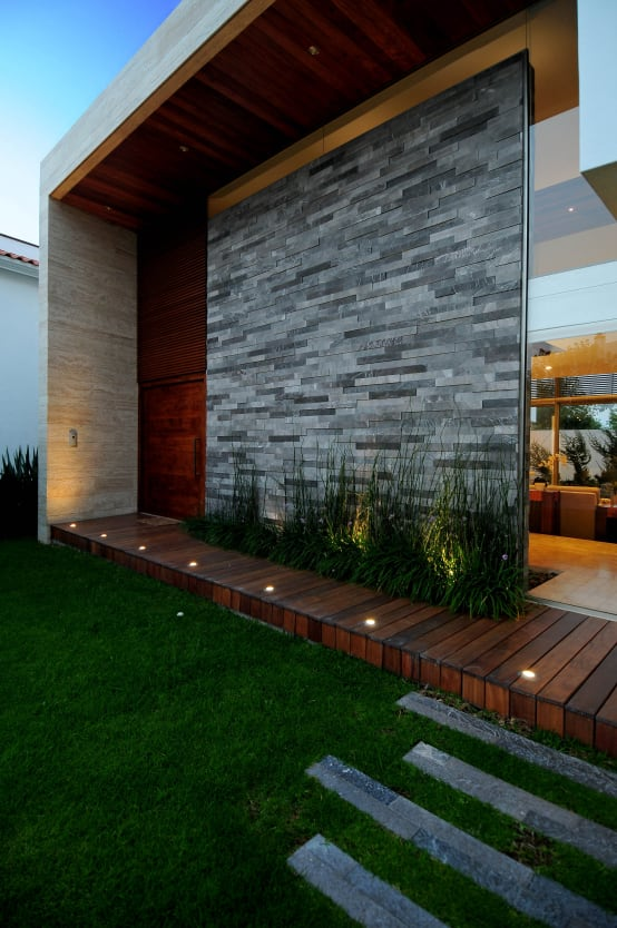 10 fant sticas ideias para cobrir com pedra a fachada de for Estilo arquitectonico que usa adornos con plantas y animales