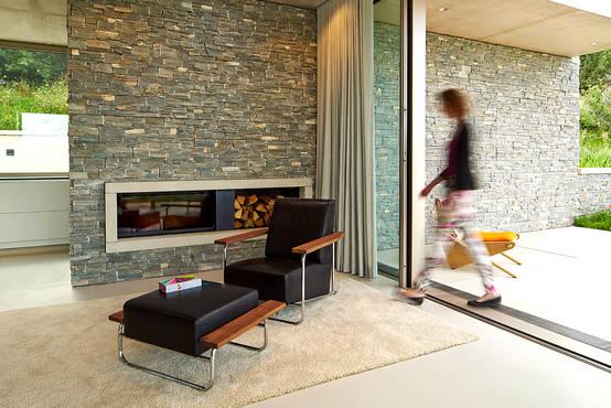 Como decorar a parede da lareira - Muri finti per interni ...