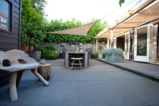 Une superbe terrasse avec pergola et arbres fruitiers !