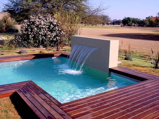 15 piscinas peque as pero maravillosas for Sombrillas para piscinas