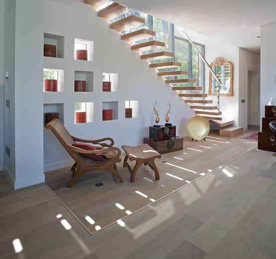 10 formas de aprovechar el espacio bajo las escaleras for Formas de escaleras