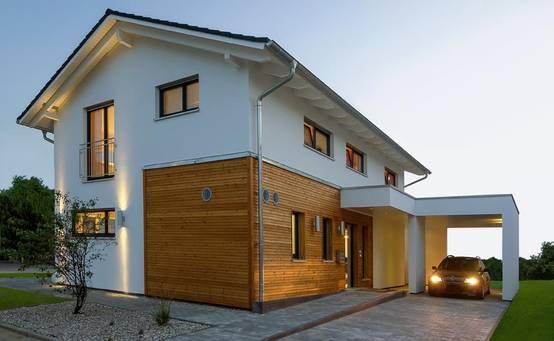 Casa customizada com luzes e cores for Holzverkleidung haus