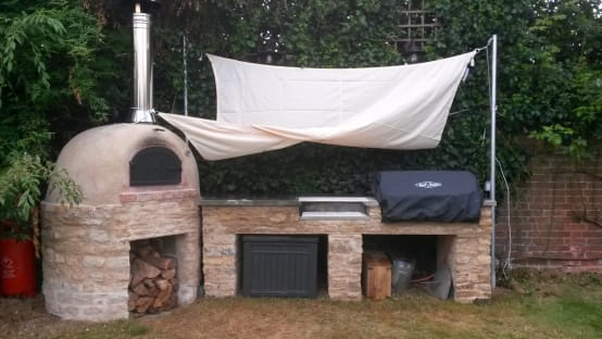 outdoor kitchen with wood-fired oven