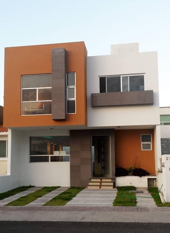 Casa de dos pisos con acabados interiores perfectos for Mejores fachadas de casas modernas