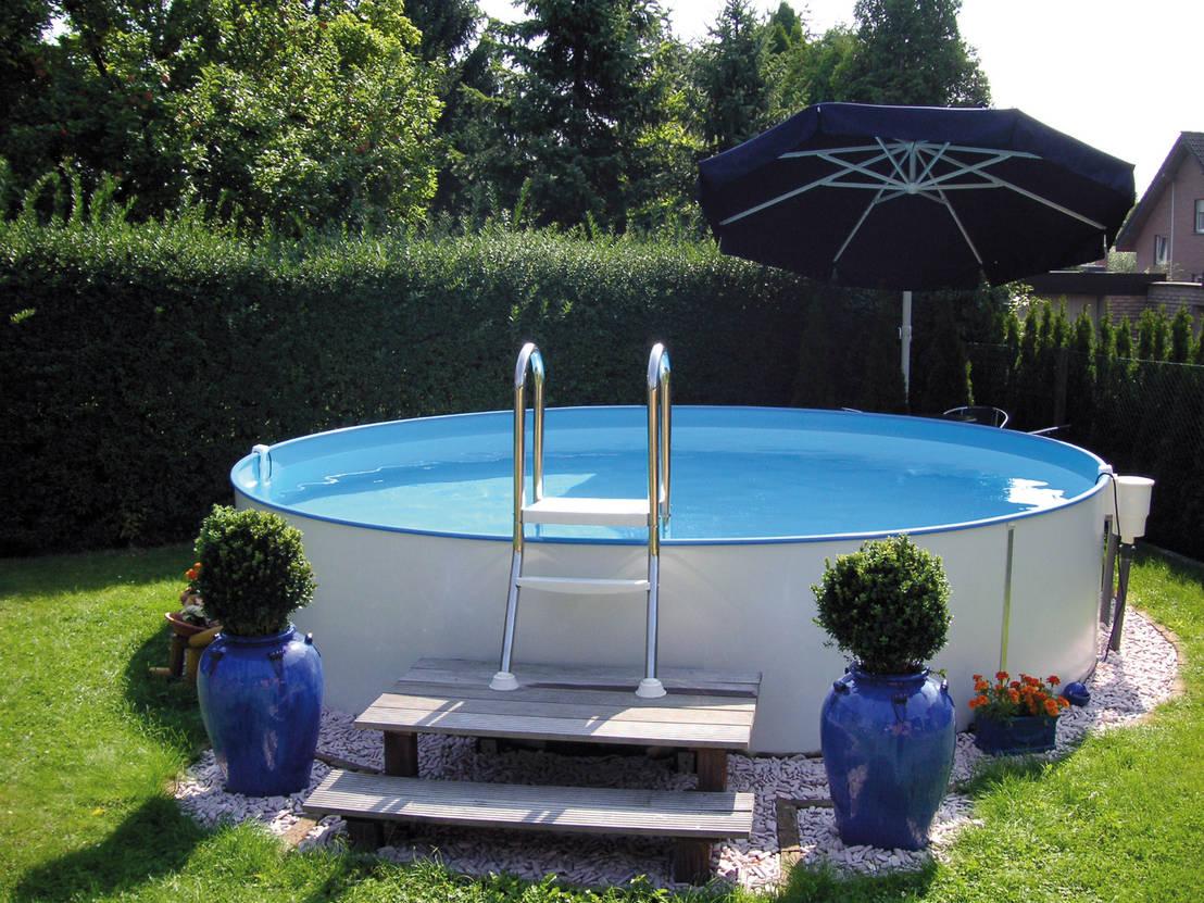 13 ideas de piscinas elevadas para tu jard n for Ideas piscinas jardin