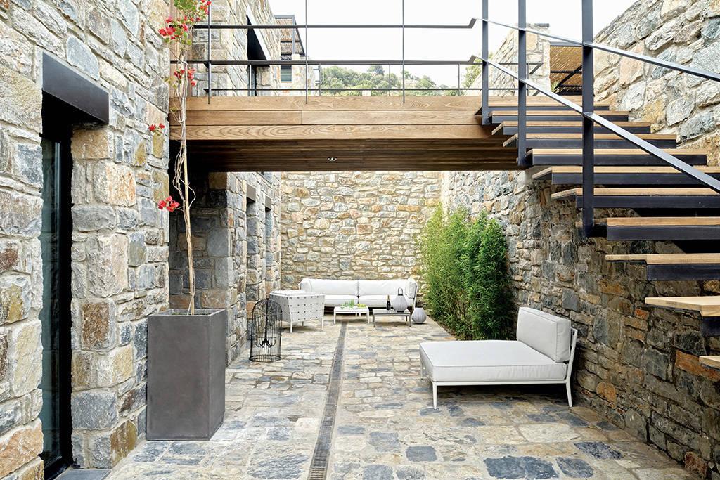 9 pisos de piedra cautivadores for Huecos de escaleras modernos