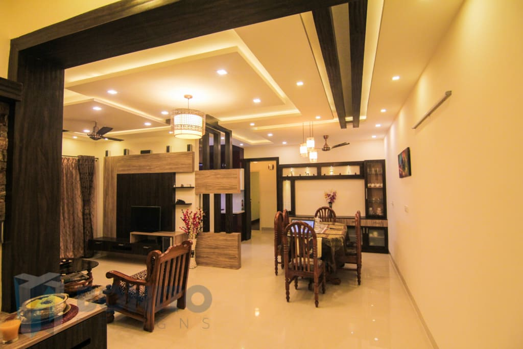 Asian living room photos living cum dining interiors homify for Living room designs bangalore