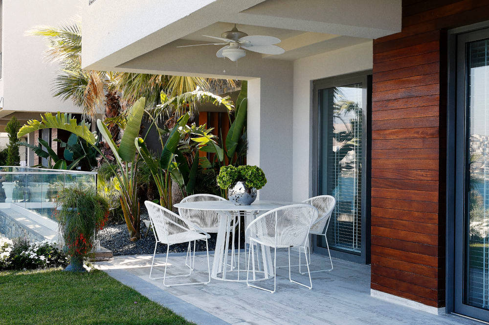 Summer house in bodrum's bay opens to the pleasures of life .